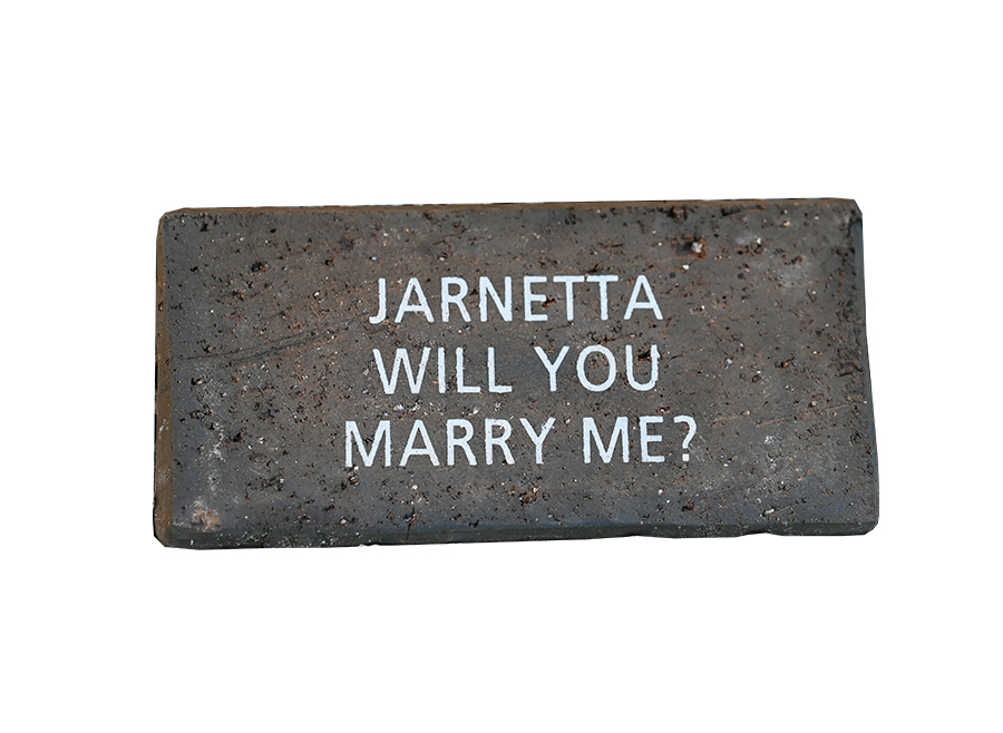 Jarnetta will you marry me? written on a brick